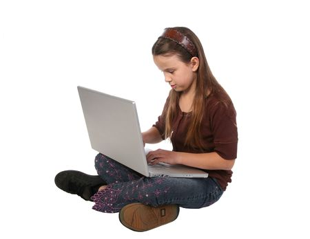 Young girl sitting with her legs crossed with a laptop computer in her lap Stock Photo - 721478