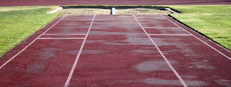Artificial turf leads to a sand pit for long jumping Stock Photo - 721470
