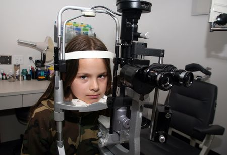 opthalmology: Young girl anxiously waiting for her eye exam
