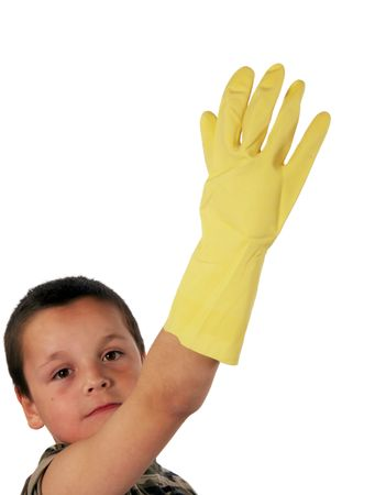 Young boy wearing a yellow rubber glove photo