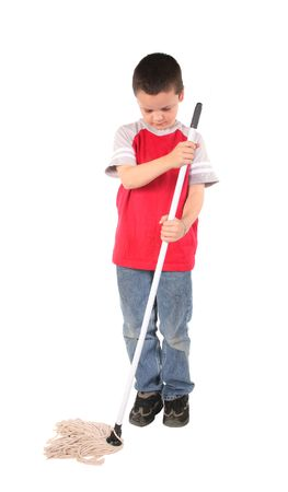 floor cloth: Young boy doing his chore of mopping the floor Stock Photo