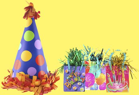 Isolated party bags and cute birthday party hat with polka dots on it Stockfoto