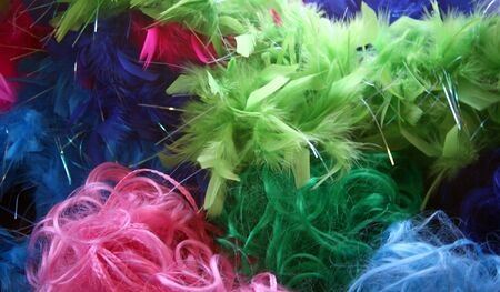 boas: Hair accessories and boas make this very colorful background Stock Photo