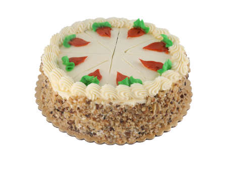 Delicious whole carrot cake with walnuts on the side and creamy icing photo