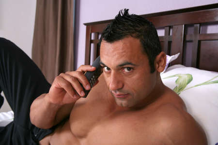Sexy hot male model talking on the phone Stock Photo - 1525638