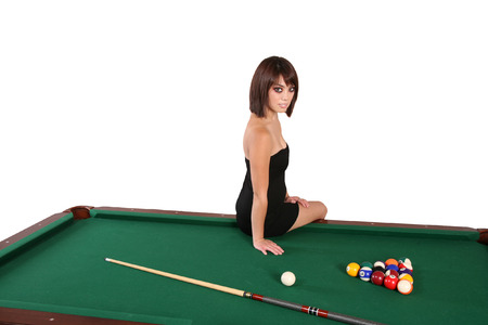 Sexy hot brunette isolated woman on a pool table photo