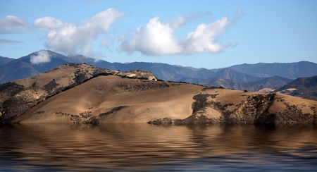 Mountains next to beautiful Lake Cachuma in California photo