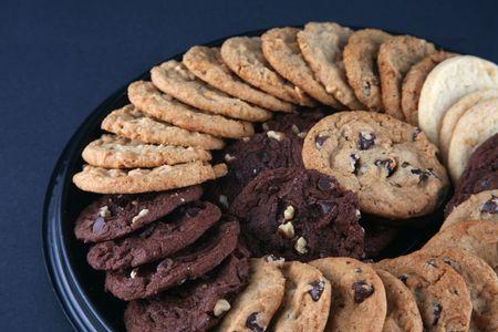 galleta de chocolate: Variedad de galletas deliciosas en un disco Foto de archivo