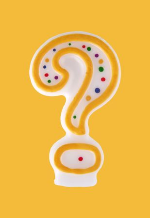 Colorful party candle in the shape of a question mark