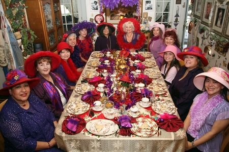 hat with feather: Twelve fashionable women sitting down for a tea party