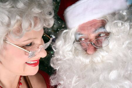 Santa clause and his wife sharing a look of love photo