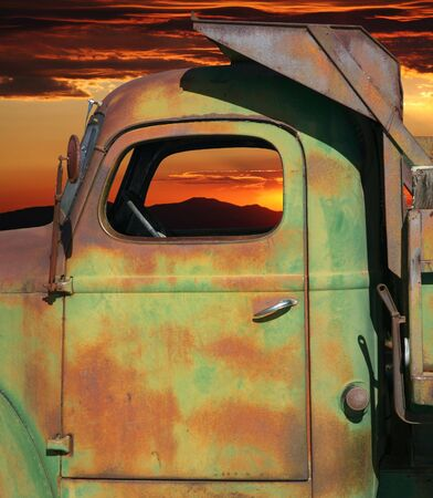 Closeup of rusty farm dump truck with colorful sky photo