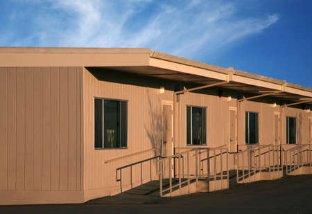Portable buildings called bungalows with blue sky Imagens