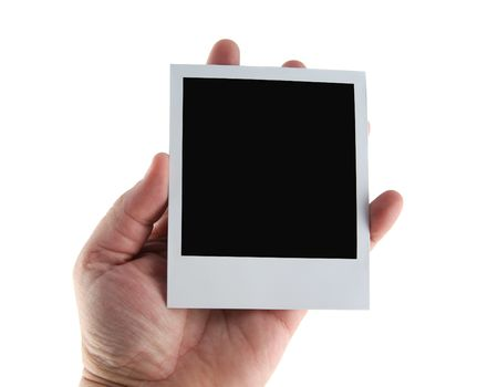 hand held: Old Polaroid film blank being held in a hand Stock Photo