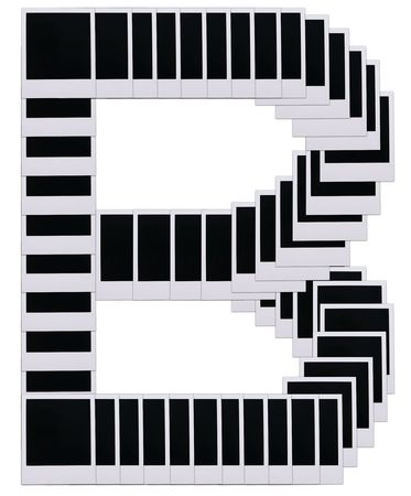 Old photo film blanks in the shape of the letter B