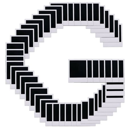Old photo film blanks in the shape of the letter G