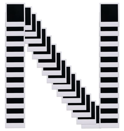 Old photo film blanks in the shape of the letter N