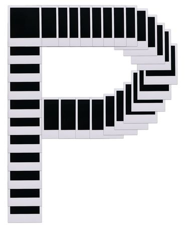 Old photo film blanks in the shape of the letter P