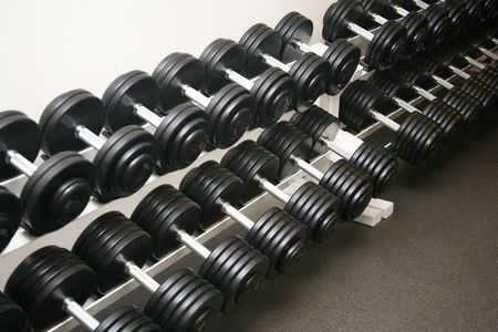 Exercise equipment neatly stored in a police gym