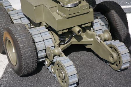 detonate: Military or police robot used to safely move or detonate bombs and mines