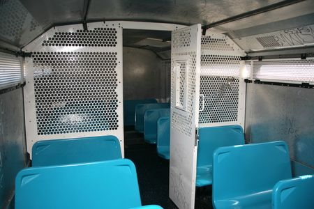 public safety: Large bus used by police to transport prisoners for public safety Stock Photo