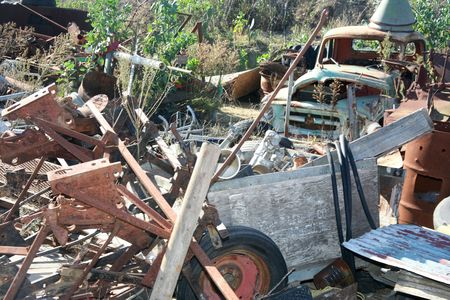 Rusty vehicle and other deteriorated salvage junk photo