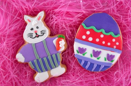 Easter egg and rabbit on artificial pink grass photo