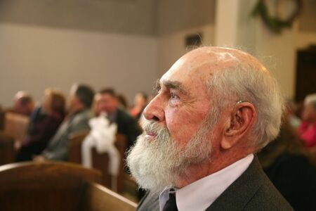 Grandfather sitting in church watching a wedding Stock Photo - 2847591