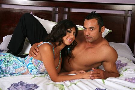 Sexy couple enjoying each other while on a bed Stock Photo - 2954665