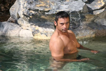 Sexy male model in a rock swimming pool Stock Photo - 2981663