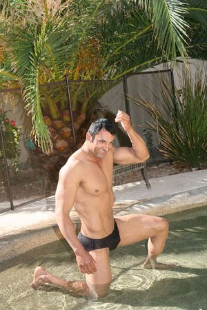 Sexy male model in a swimming pool Stock Photo - 2981664