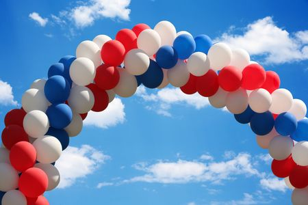 Beautiful blue heavenly and soft cloudy sky with a patriotic balloon arch Stock Photo - 2993747