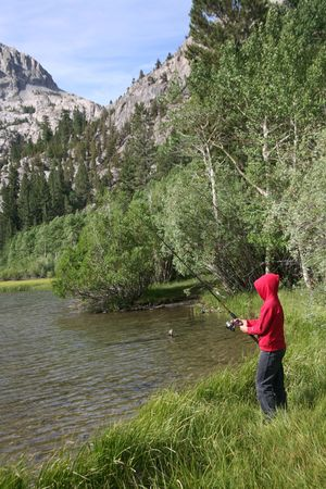 sierras: Young fisherman enjoying the great outdoors in the high sierras in California Stock Photo