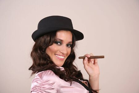 Sexy brunette woman getting ready to light her cigar photo