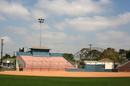 Sports backstop and stadium bleachers ready for a softball or baseball game Stock Photo