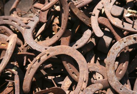 Old rusty used horseshoes with the nails still in them Stock Photo
