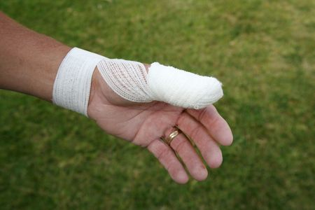 flesh surgery: Hurt thumb with surgical dressing on the hand of an older man wearing a  ring Stock Photo