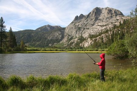 sierras: Young fisherman enjoying nature in the High Sierras of California
