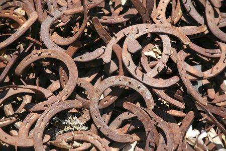 Rusty old horseshoes with nails on them background Stock Photo
