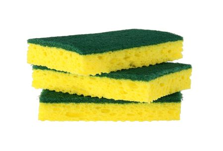 Yellow sponge with grren scrubber attached isolated on white background Stock Photo