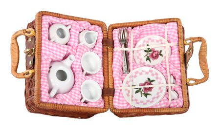 Basket with coffee or tea party porcelain dishware isolated on white background  photo