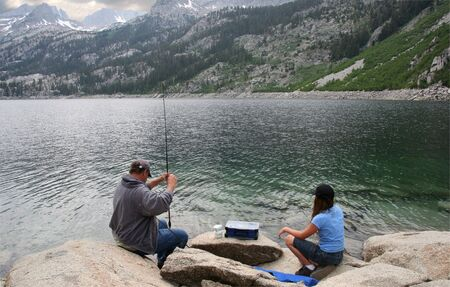 sierras: Father and daughter fishing in a High Sierras lake