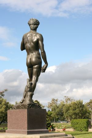 nudist: Statue of Michelangelos David.  This is a copy located in a cemetary in Southern California