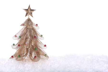 Gold Christmas tree isolated on white background photo