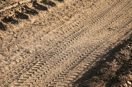 Dirt background with vehicle pattern track Stock Photo - 4578205