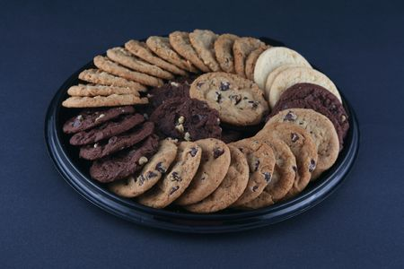 dough nut: Variety of delicious cookies on a platter Stock Photo