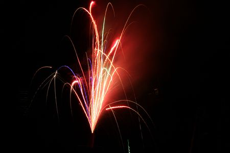 Patriotic colored fireworks background on black night sky