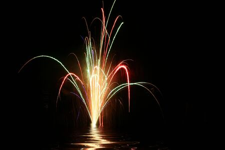 Colorful holiday fireworks on black background Stock Photo