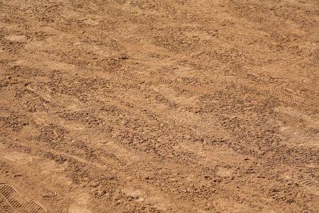 Sandy soil: De fondo textura natural de la tierra, con huellas de Foto de archivo