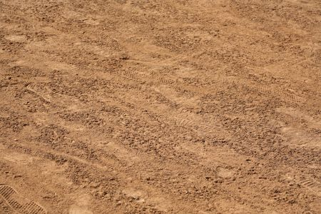 dirt road: Natural texture background of dirt with footprints Stock Photo